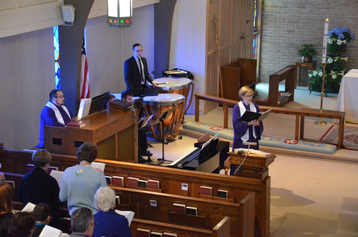 Worship Service, Easter Day 2015, cantor leads psalm while guest musician looks on