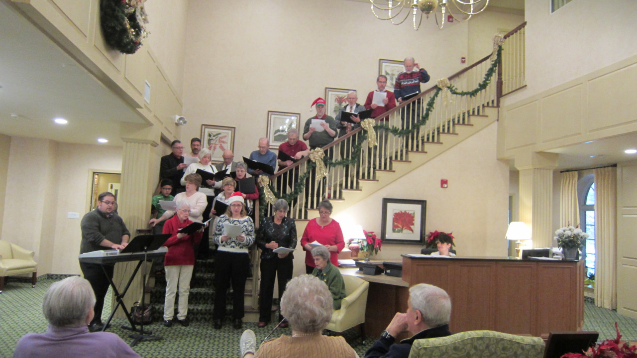 More Christmas Caroling brought by choir and parishioners to nursing home residents