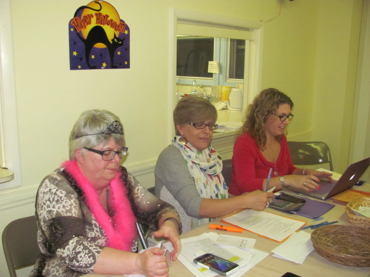 Check out team in action at the Silent Auction, October 31 2015